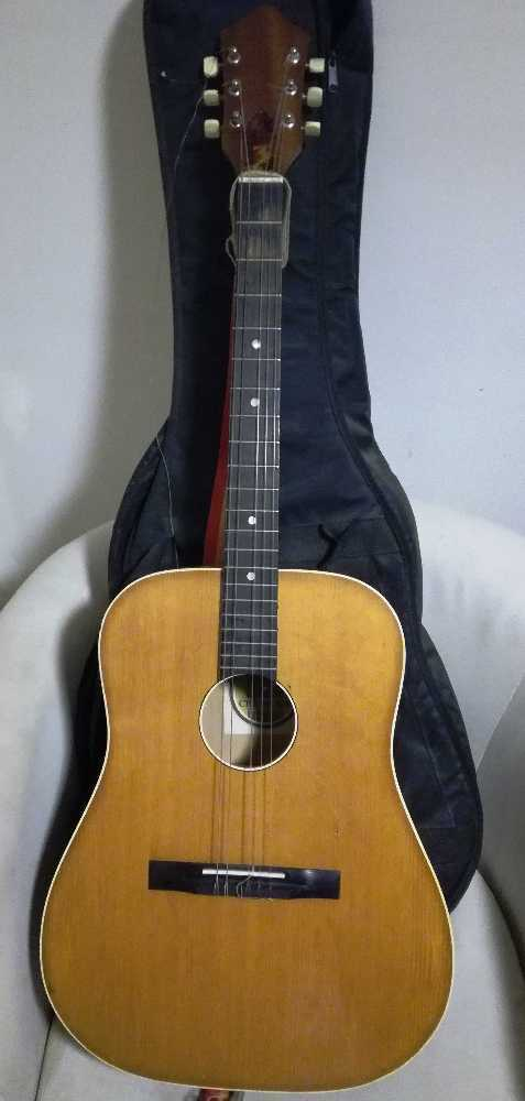 Acoustic guitar with case in london