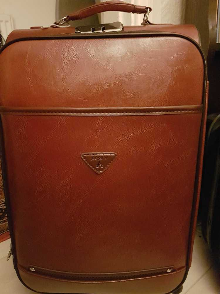 Beautiful leather luggage reddish brown in london
