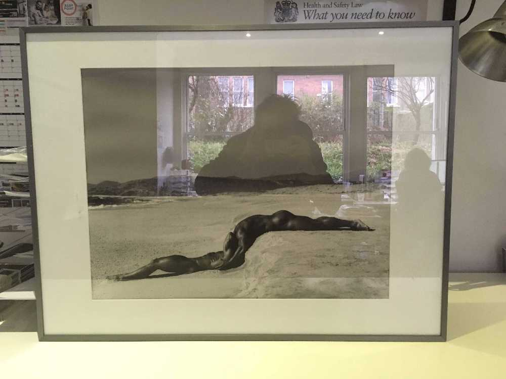 Framed photograph of nudes on a beach in london