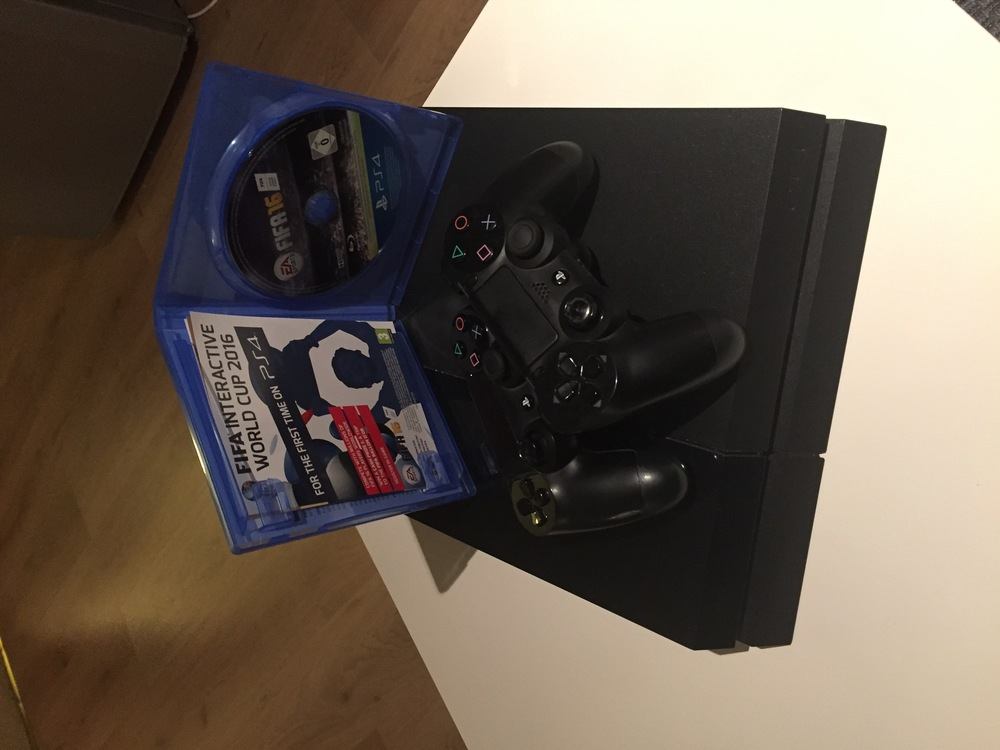 PlayStation 4 w/ FIFA 16 in london